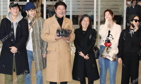 Lee Sun-gyun, Choi Woo-shik, Song Kang-ho, producer Kwak Sin-ae, and actresses Park So-dam and Cho Yeo-jeong, who starred in the Oscar-winning Korean film Parasite, arrive at Incheon airport, west of Seoul, South Korea, 12 February 2020. The movie by South Korean director Bong Joon-ho won four Academy Awards on 09 February for Best Original Screenplay, Best International Feature Film, Best Director and Best Picture. It is the first time a foreign-language movie wins the Academy Award for Best Picture.