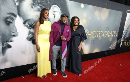 """Stock Image of Issa Rae, Will Packer, Stella Meghie. Actress Issa Rae left, producer Will Packer and director Stella Meghie attend the world premiere of """"The Photograph"""" at the SVA Theatre, in New York"""