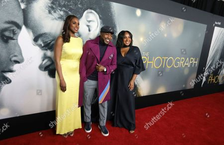 """Stock Picture of Issa Rae, Will Packer, Stella Meghie. Actress Issa Rae left, producer Will Packer and director Stella Meghie attend the world premiere of """"The Photograph"""" at the SVA Theatre, in New York"""
