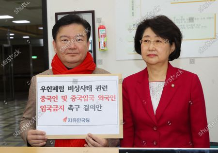 South Korean Reps. Min Kyung-wook (L) and Kim Seung-hee (R) of the main opposition Liberty Korea Party show off a bill to prevent Chinese tourists and foreigners who have visited China from entering the country, prior to submitting it to the National Assembly in Seoul, South Korea, 12 February 2020. The disease caused by the novel coronavirus (SARS-CoV-2) has been officially named Covid-19 by the World Health Organization (WHO). The outbreak, which originated in the Chinese city of Wuhan, has so far killed at least 1,116 people, with over 45,000 infected worldwide, mostly in China.