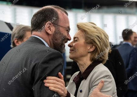 President of the European Commission Ursula von der Leyen (R) hugs Chairman of the EPP Group in the European Parliament Manfred Weber (L) before the debate on the Preparation of the Extraordinary European Council Meeting on the Multiannual Financial Framework at the European Parliament in Strasbourg, France, 12 February 2020. The extraordinary meeting will take place on 20 February 2020.