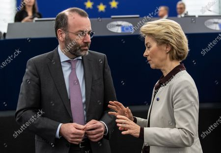 President of the European Commission Ursula von der Leyen (R) speaks with Chairman of the EPP Group in the European Parliament Manfred Weber (L) before the debate on the Preparation of the Extraordinary European Council Meeting on the Multiannual Financial Framework at the European Parliament in Strasbourg, France, 12 February 2020. The extraordinary meeting will take place on 20 February 2020.