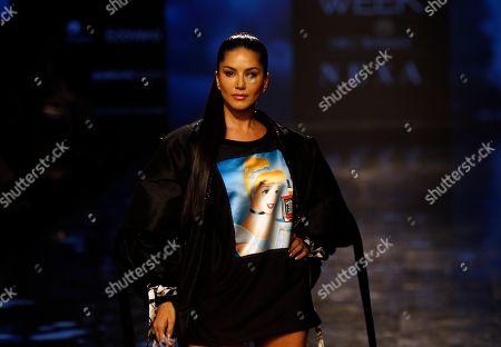 Bollywood actress Sunny Leone walks the ramp to showcase the creation of designer Swapnil Shinde during the Lakme Fashion Week in Mumbai, India