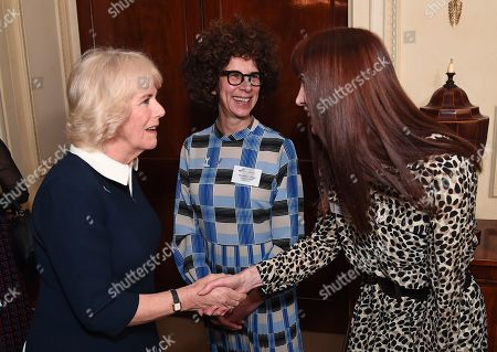 Stock Picture of Camilla Duchess of Cornwall talks to SafeLives staffers Michelle Phillips and Melani Morgan during a reception to acknowledge the 15th anniversary of domestic abuse charity SafeLives at Clarence House