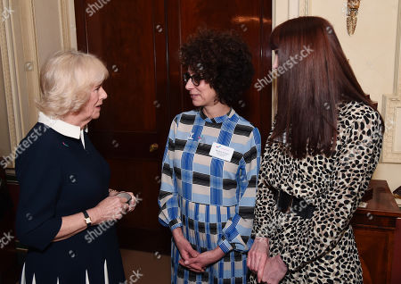 Stock Image of Camilla Duchess of Cornwall talks to SafeLives staffers Michelle Phillips and Melani Morgan during a reception to acknowledge the 15th anniversary of domestic abuse charity SafeLives at Clarence House