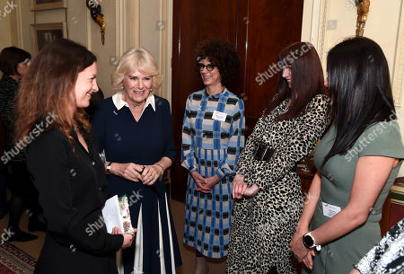 Camilla Duchess of Cornwall talks to CEO of SafeLives Suzanne Jacob (L), SafeLives staffers Michelle Phillips, Melani Morgan and Susie Hay during a reception to acknowledge the 15th anniversary of domestic abuse charity SafeLives at Clarence House