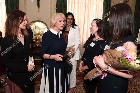 Camilla Duchess of Cornwall (2nd L) talks to CEO of SafeLives Suzanne Jacob (L), Ambassador Women's Trust Teresa Falcone and SafeLives Pioneers Celia Peachey and Rachel Williams during a reception to acknowledge the 15th anniversary of domestic abuse charity SafeLives at Clarence House
