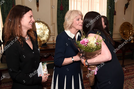 Camilla Duchess of Cornwall (2nd L) is greeted by CEO of SafeLives Suzanne Jacob (L) and SafeLives Pioneers Celia Peachey and Rachel Williams during a reception to acknowledge the 15th anniversary of domestic abuse charity SafeLives at Clarence House