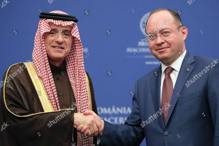 Saudi Minister of State for Foreign Affairs Adel al-Jubeir shakes hands with Romanian Foreign Minister Bogdan Aurescu in Bucharest, Romania