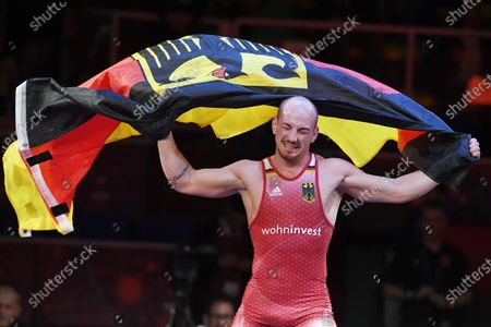 Frank Staebler of Germany celebrates his victory against Iuri Lomadze of Georgia in the final of men's Greco-Roman wrestling 72-kg category of the European Wrestling Championships in Rome, Italy, 12 February 2020.