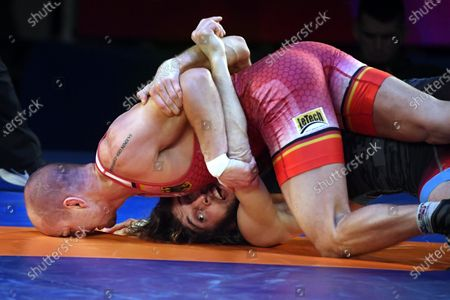 Frank Staebler (red) of Germany and Iuri Lomadze of Georgia fight in the final of men's Greco-Roman wrestling 72-kg category of the European Wrestling Championships in Rome, Italy, 12 February 2020.