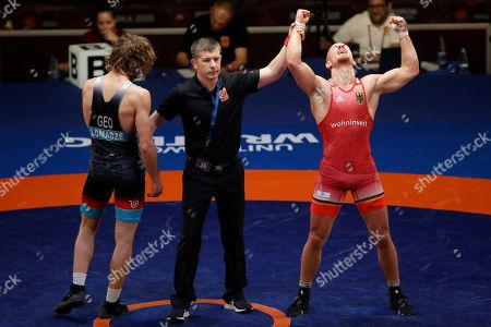 Germany's Frank Staebler, right, celebrates after beating Georgia's Iuri Lomadze during the final of the 72Kg category of the men's Greco-Roman wrestling event, at the European Wrestling Championships in Ostia, Italy