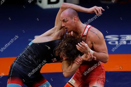 Stock Photo of Germany's Frank Staebler, right, takes on Georgia's Iuri Lomadze during the final of the 72Kg category of the men's Greco-Roman wrestling event, at the European Wrestling Championships in Ostia, Italy