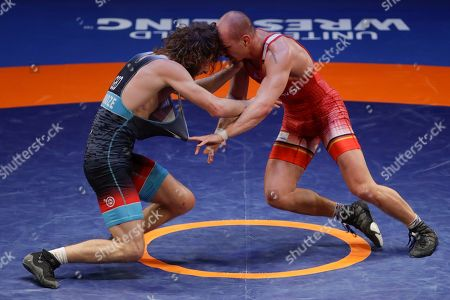 Germany's Frank Staebler, right, takes on Georgia's Iuri Lomadze during the final of the 72Kg category of the men's Greco-Roman wrestling event, at the European Wrestling Championships in Ostia, Italy