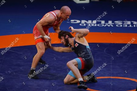 Germany's Frank Staebler, left, takes on Georgia's Iuri Lomadze during the final of the 72Kg category of the men's Greco-Roman wrestling event, at the European Wrestling Championships in Ostia, Italy