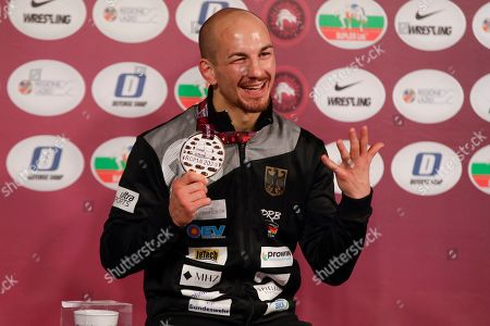 Stock Picture of Germany's Frank Staebler poses with the gold medal after winning the final of the 72Kg category of the men's Greco-Roman wrestling event, at the European Wrestling Championships in Ostia, Italy