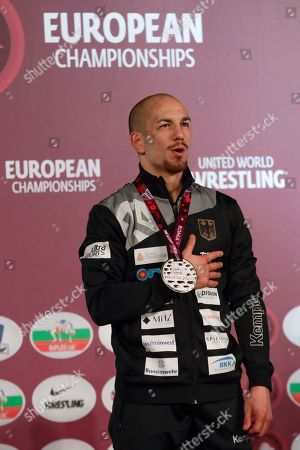 Stock Image of Germany's Frank Staebler poses with the gold medal after winning the final of the 72Kg category of the men's Greco-Roman wrestling event, at the European Wrestling Championships in Ostia, Italy