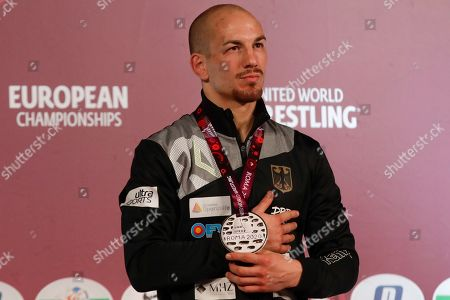 Germany's Frank Staebler poses with the gold medal after winning the final of the 72Kg category of the men's Greco-Roman wrestling event, at the European Wrestling Championships in Ostia, Italy