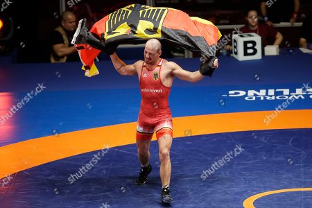 Germany's Frank Staebler celebrates after beating Georgia's Iuri Lomadze during the final of the 72Kg category of the men's Greco-Roman wrestling event, at the European Wrestling Championships in Ostia, Italy