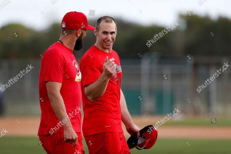 St. Louis Cardinals' Paul Goldschmidt, right, talks with teammate Matt Carpenter during spring training baseball practice, in Jupiter, Fla