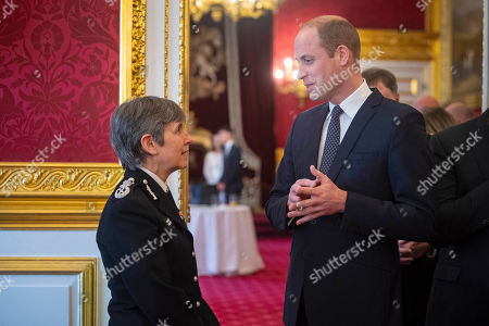 Prince William talks with Metropolitan Police Commissioner Cressida Dick during a Metropolitan and City Police Orphans Fund reception at St James's Palace, London, to mark the 150th anniversary of the Fund