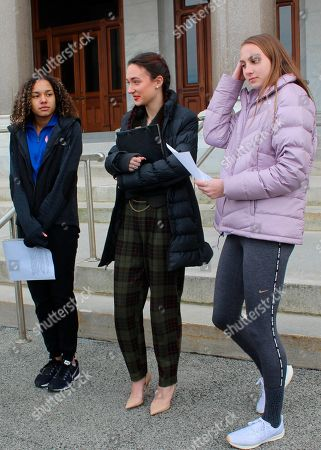 High school track athletes Alanna Smith, left, Selina Soule, center and and Chelsea Mitchell prepare to speak at a news conference outside the Connecticut State Capitol in Hartford, Conn. on . The three girls have filed a federal lawsuit to block a state policy that allows transgender athletes to compete in girls sports