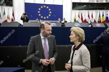 European Commission President Ursula von der Leyen speaks with Chairman of the center-right European People Party group Manfred Weber
