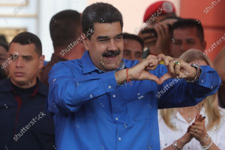 President of Venezuela Nicolas Maduro (C) participates with the first lady of Venezuela Cilia Flores (Back-R) in a demonstration with supporters of his government for the youth day, in Caracas, Venezuela, 12 February 2020.