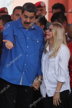 President of Venezuela Nicolas Maduro (L) participates with the first lady of Venezuela Cilia Flores (R) in a demonstration with supporters of his government for the youth day, in Caracas Venezuela, 12 February 2020.