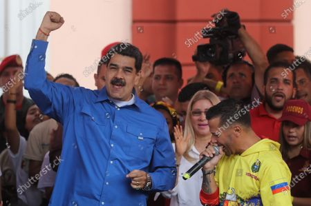 President of Venezuela Nicolas Maduro (L) participates with the first lady of Venezuela Cilia Flores (back-C) in a demonstration with supporters of his government for the youth day, in Caracas Venezuela, 12 February 2020.