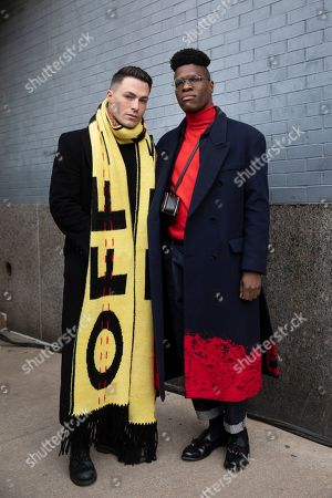 Stock Photo of Actor Colton Haynes, left, and Jasper Brown, with Women's Wear Daily, pose after attending a show during Fashion Week, in New York