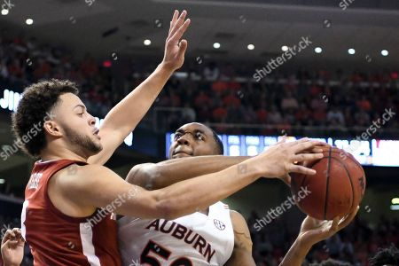 Stock Photo of Auburn center Austin Wiley (50) shoots over Alabama forward Alex Reese (3) during the first half of an NCAA college basketball game Wednesday, in Auburn, Ala