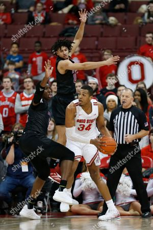 Ohio State's Kaleb Wesson, right, posts up against Rutgers Geo Baker, top, and Shaq Carter during the first half of an NCAA college basketball game, in Columbus, Ohio