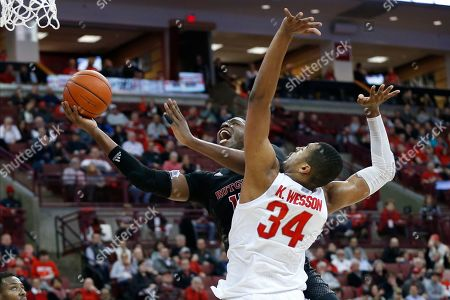 Rutgers' Shaq Carter, left, shoots past Ohio State's Kaleb Wesson during the first half of an NCAA college basketball game, in Columbus, Ohio