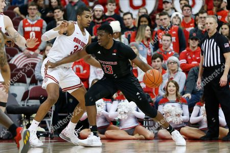Rutgers' Shaq Carter, right, posts up against Ohio State's Kaleb Wesson during the second half of an NCAA college basketball game, in Columbus, Ohio. Ohio State beat Rutgers 72-66