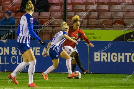 Kirsty Barton (Brighton & Hove) & Lauren James (Manchester United) during the FA Women's Super League match between Brighton and Hove Albion Women and Manchester United Women at The People's Pension Stadium, Crawley