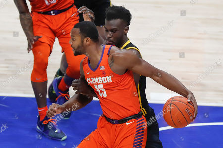 Clemson's John Newman III (15) tries to get past Pittsburgh's Eric Hamilton during the first half of an NCAA college basketball game, in Pittsburgh