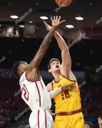 Iowa State forward Michael Jacobson (12) tries to get to a rebound before Oklahoma forward Kristian Doolittle (21) does during the first half of an NCAA college basketball game in Norman, Okla