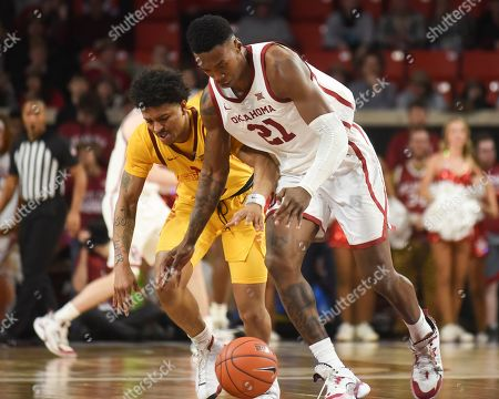 Oklahoma forward Kristian Doolittle (21) tries to steal the ball from Iowa State Prestiss Nixon (11) during the second half of an NCAA college basketball game in Norman, Okla