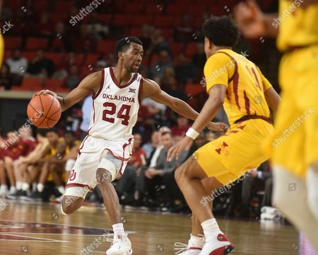 Stock Picture of Oklahoma guard Jamal Bieniemy (24) tries to push past Iowa State guard Prentiss Nixon (11) during the second half of an NCAA college basketball game in Norman, Okla