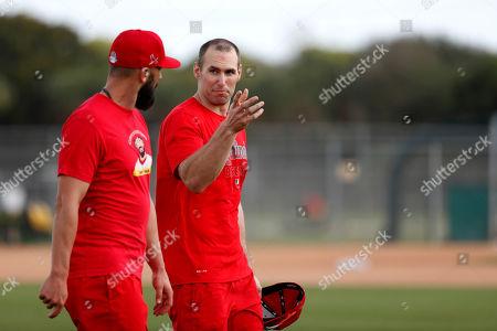 Stock Picture of St. Louis Cardinals' Paul Goldschmidt, right, talks with Matt Carpenter during spring training baseball practice, in Jupiter, Fla