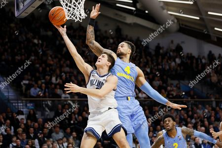 Collin Gillespie, Theo John. Villanova's Collin Gillespie, left, goes up for a shot past Marquette's Theo John during the second half of an NCAA college basketball game, in Villanova, Pa
