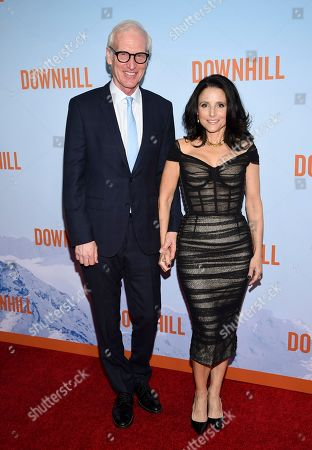 """Brad Hall, Julia Louis-Dreyfus. Actress Julia Louis-Dreyfus, right, and husband Brad Hall attend the premiere of """"Downhill"""" at the SVA Theatre on, in New York"""