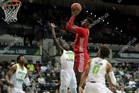 Houston's Chris Harris Jr. shoots over South Florida's Madut Akec (22) as Michael Durr (4) and David Collins (0) watch during the first half of an NCAA college basketball game, in Tampa, Fla