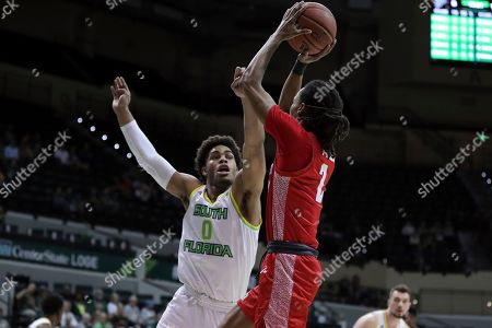 Houston's Caleb Mills shoots over South Florida's David Collins during the first half of an NCAA college basketball game, in Tampa, Fla