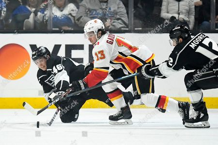 Blake Lizotte, Trevor Moore, Johnny Gaudreau. Los Angeles Kings center Blake Lizotte, left, and center Trevor Moore, right, work against Calgary Flames left wing Johnny Gaudreau during the second period of an NHL hockey game, in Los Angeles