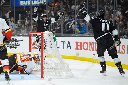 Tyler Toffoli, Anze Kopitar, David Rittich. Los Angeles Kings right wing Tyler Toffoli, rear, celebrates with center Anze Kopitar, right, after Toffoli scored on Calgary Flames goaltender David Rittich during the second period of an NHL hockey game, in Los Angeles