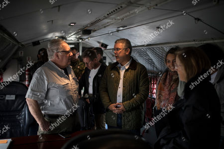Stock Image of Howard Buffett, left, talks to Colombia's President Ivan Duque aboard an air force plane before departing from Bogota, Colombia. Duque has vowed to slash cocaine production in half by the end of 2023