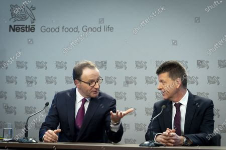 Nestle's CEO Ulf Mark Schneider (L) speaks with Nestle's CFO Francois-Xavier Roger (R) during the 2019 full-year results press conference of the food and drinks giant Nestle in Vevey, Switzerland, 13 February 2020.