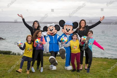 Stock Photo of UEFA Playmakers - Nicole Morse (Disney - left) and Nadine Kessler (UEFA - right) with Playmaker girls Apolline, Lana, Minnie Mouse, Mickey Mourse, Chloe and Julia